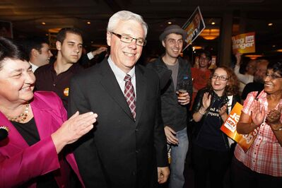 Premier Greg Selinger and wife Claudette (left) enter Manitoba NDP election headquarters two years ago after yet another victory for the party at the polls.