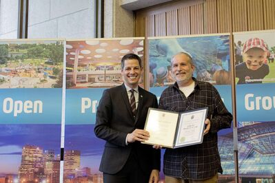 Mike Wolchok (right) of Pollock's Hardware accepts an award for the Osborne South Business Improvement Zone from Mayor Brian Bowman.