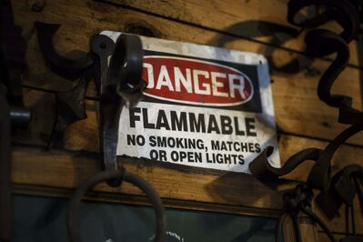 A sign warns against open flames close to the gas-fired forge.