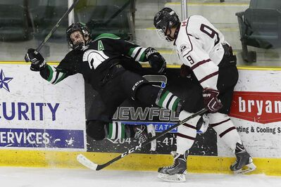 JOHN WOODS / WINNIPEG FREE PRESS</p><p>St Paul's Crusaders' Kieran Guttormson checks Vincent Massey Trojans' Keegan Fraser in the Manitoba Boys High School Hockey Championship in Portage La Prairie Monday.</p>