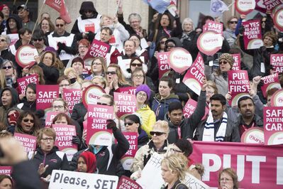 The noon-hour rally in front of the Manitoba Legislative Building was the largest and most boisterous protest yet against the hospital reorganization plan. (Jen Doerksen / Winnipeg Free Press)</p>