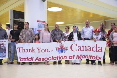 JUSTIN SAMANSKI-LANGILLE / WINNIPEG FREE PRESS</p><p>Members of the welcoming party for 12-year-old Emad Mishko Tamo are seen holding a sign early Thursday morning at Winnipeg James Armstrong Richardson International Airport.</p>