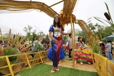 Fancy outfits, such as a dress designed to look like the flag of the Philippines, weren&rsquo;t hard to find at the festival.</p>