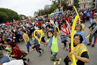 Smiles were plentiful among the thousands of people celebrating their culture.</p>