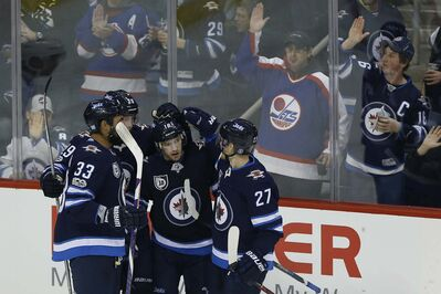JOHN WOODS / WINNIPEG FREE PRESS</p><p>Winnipeg Jets celebrate Bryan Little&#39;s goal against the Arizona Coyotes during second period in Winnipeg on Tuesday. It was Little&#39;s second goal of the season and his first in 11 games.</p>