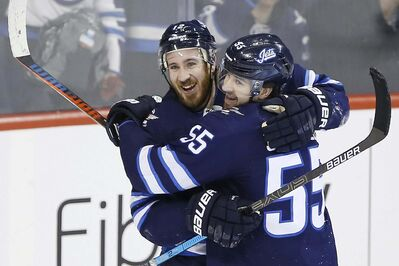 Winnipeg Jets' Kevin Hayes, left, and Mark Scheifele celebrate Hayes' his first goal for the Jets since his recent trade to the team during NHL action against the Nashville Predators, last Friday.