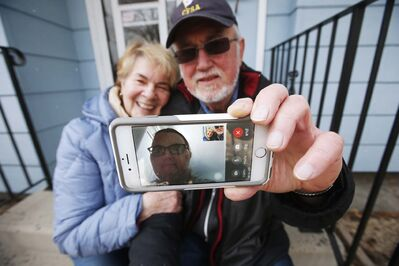 Kay and John Lehr talk to their daughter Karen, 44, who lives in a group home. The family stays in touch through video conferencing and phone calls and is grateful to have those tools available.</p></p>