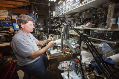 Barry Malowanchuk uses his station, among other purposes, to bounce signals off the moon to communicate with other hams, testing his ability to build sensitive receivers and effective antennas.