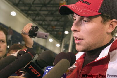 Dany Heatley speaks at a news conference in Kelowna on Friday, trying to clear the air before Team Canada's orientation camp opens on Monday.