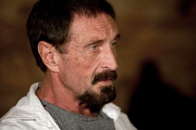 """FILE - In this Dec. 4, 2012, file photo, software company founder John McAfee listens to a question during an interview at a local restaurant in Guatemala City. McAfee said Sunday, Dec. 9, 2012, a live-stream Internet broadcast from the Guatemalan detention center where he is fighting a government order that he be returned to Belize, that he wants to return to the United States and """"settle down to whatever normal life"""" he can. Police in neighboring Belize want to question McAfee in the fatal shooting of a U.S. expatriate who lived near his home on a Belizean island in November. (AP Photo/Moises Castillo, File)"""