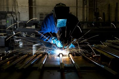 In this July 16, 2014 photo, a welder fabricates anchor bolts for roads and bridges at the custom manufacturer Fox Company Inc. in Philadelphia. The Institute for Supply Management, a trade group of purchasing managers, issues its index of manufacturing activity for July on Friday, Aug. 1, 2014. (AP Photo/Matt Rourke)
