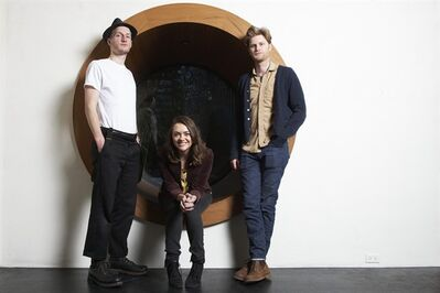 This Jan. 18, 2013 photo shows members of the American folk rock band The Lumineers, from left, Jeremiah Fraites, Neyla Pekarek and Wesley Schultz at the Dream Downtown Hotel in New York. Grammy nominees the Lumineers, Jack White and Carrie Underwood will perform at the Feb. 10 awards show. (Photo by Dan Hallman/Invision/AP)
