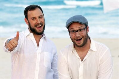 "FILE - This April 21, 2013 file photo shows Evan Goldberg, left, and Seth Rogen, posing on a beach as they promote their film ""This is The End"", in Cancun, Mexico. Sony Pictures will make a raunchy, R-rated animated film written by Seth Rogen and Evan Goldberg titled ""Sausage Party."" The project was announced Tuesday, Sept. 24, by Sony, which is co-financing the film with Annapurna Pictures. (AP Photo/Alexandre Meneghini, File)"