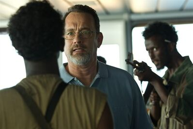 """This film image released by Sony - Columbia Pictures shows Tom Hanks, center, in a scene from """"Captain Phillips."""" The film was nominated for a Directors Guild award on Tuesday, Jan. 7, 2014. The winners will be announced on Jan. 25. (AP Photo/Sony - Columbia Pictures)"""