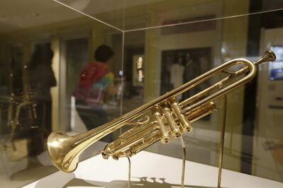 A trumpet belonging to Louis Armstrong is on display for patrons at the Louis Armstrong House Museum Wednesday, Oct. 9, 2013, in the Queens borough of New York. The Selmer Trumpet was a gift from King George V in 1933. (AP Photo/Frank Franklin II)