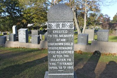 "FILE - This undated file photo provided by Destination Halifax shows the ""Unknown Child"" gravestone at the Fairview Lawn Cemetery, in Halifax, Nova Scotia, where 121 Titanic victims are buried. Ships dispatched from Halifax to the site of the Titanic disaster 100 years ago recovered more than 330 bodies, and the city is hosting exhibits, talks and tours to mark the centennial of the sinking. (AP Photo/Destination Halifax, File)"