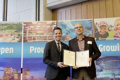 Normand Gousseau of Entreprises Riel (right) was honoured by Mayor Brian Bowman on May 14 for his work with the newly formed St. Norbert Business Improvement Zone.