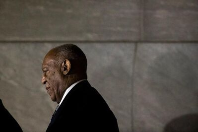 Bill Cosby walks from the Montgomery County Courthouse during his sexual assault trial in Norristown, Pa., Friday, June 16, 2017. (AP Photo/Matt Rourke)