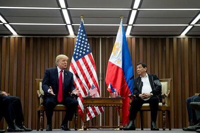 U.S. President Donald Trump, left, accompanied by Philippines President Rodrigo Duterte speaks during a bilateral meeting at the ASEAN Summit at the Philippine International Convention Center, Monday, Nov. 13, 2017, in Manila, Philippines. (AP Photo/Andrew Harnik)