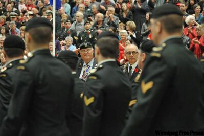 Alberta's Lieutenant Governor Donald S. Ethell (from left) and Edmonton Mayor Stephen Mandel inspect the troops. Remembrance Day ceremony on the University of Alberta Campus.