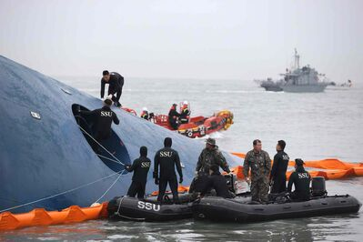 South Korean rescue team members search for passengers aboard a ferry sinking off South Korea's southern coast, in the water off the southern coast near Jindo, south of Seoul, South Korea, Thursday.