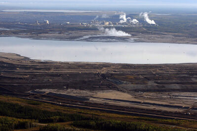 This Sept. 19, 2011 aerial photo shows a tar sands tailings pond at a mine facility near Fort McMurray, Alta.