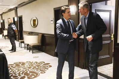Pallister says he treats Prime Minister Justin Trudeau the way he himself would like to be treated. (John Woods / The Canadian Press)