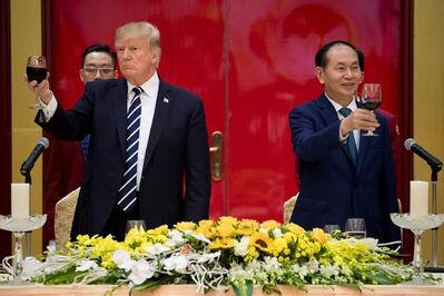 President Donald Trump and Vietnamese President Tran Dai Quang toast during a State Dinner at the International Convention Center, Saturday, Nov. 11, 2017, in Hanoi, Vietnam. Trump is on a five country trip through Asia traveling to Japan, South Korea, China, Vietnam and the Philippines. (AP Photo/Andrew Harnik)