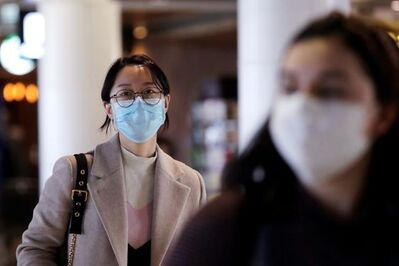 It is not clear there is any significant benefit to wearing masks to prevent influenza-like illnesses, including COVID-19, in community settings, says Manitoba Health. (Elaine Thompson / The Associated Press)
