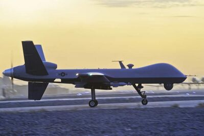 A U.S. MQ-9 Reaper drone taxis at Kandahar Airfield, Afghanistan, in December 2009.