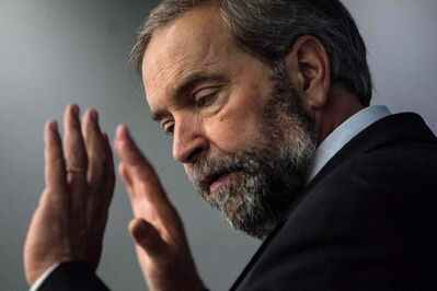 Federal NDP Leader Thomas Mulcair speaks to the Toronto Region Board of Trade on June 20, 2014. Prime Minister Stephen Harper has taken a chopper tour of flood-stricken southern Manitoba but apparently his government doesn't see any need for NDP Leader Tom Mulcair to see the disaster zone for himself.