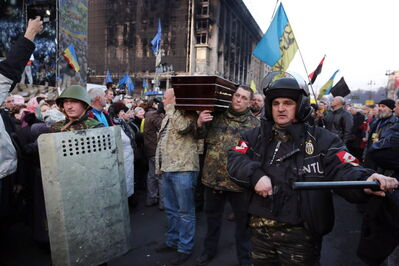 Thousands of people pay last respects to the victims of Thursday violence as caskets with their bodies are brought to Independence Square one by one Friday afternoon, Feb. 21, 2014, in Kiev, Ukraine.
