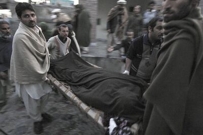 Pakistani men carry the body of a teacher, who was killed by gunmen, from a hospital for burial in Swabi, Pakistan, Tuesday, Jan. 1, 2013. Gunmen in northwest Pakistan killed five female teachers and two aid workers on Tuesday in an ambush on a van carrying workers home from their jobs at a community center, officials said. (AP Photo/Mohammad Sajjad)