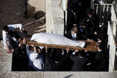 Ultra-Orthodox Jews carry the body of Rabbi Ovadia Yosef during his funeral procession in Jerusalem, Monday, Oct. 7, 2013. Rabbi Yosef, 93, a religious scholar and spiritual leader of Israel's Sephardic Jews, transformed his downtrodden community of immigrants from North Africa and Arab nations and their descendants into a powerful force in Israeli politics. (AP Photo/Oded Balilty)