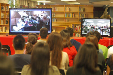 Sisler High School students watch a surgeon reconstruct a ligament in a patient's knee streamed online.