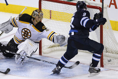 The Jets' Evander Kane pots the winner against Bruins goaltender Tuukka Rask in the third period at the MTS Centre Tuesday