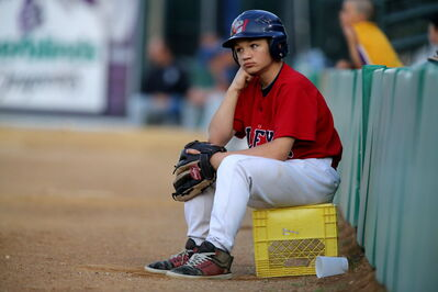 A ball boy looks on as the Winnipeg Goldeyes play against the St.Paul Saints in early July.