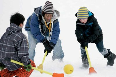 (From left to right) Vic Wang, Roh Guenka and Kade Lowes play broomball at a previous Acadia Junior High Mid-Winter Festival. The 2014 festival is scheduled to take place Feb. 1 at Fort Richmond Collegiate.
