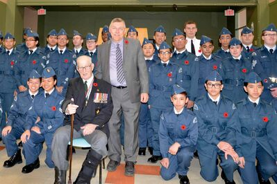 Elmwood MLA Jim Maloway with Stanley Miner, World War II Navy and Burma Veteran, and members of the 177 Air Canada Royal Canadian Air Cadet Squadron at the Prince Edward Legion No. 81 Remembrance Day ceremony.
