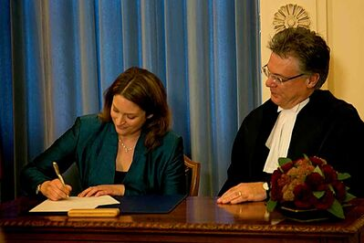 Southdale MLA Erin Selby being sworn in as Minister of Health by  Richard J.F. Chartier, Chief Justice of Manitoba.
