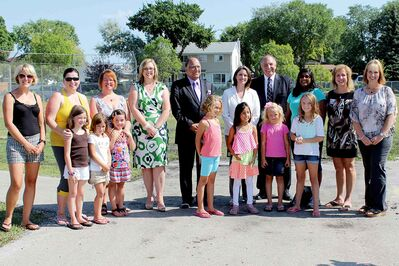 Tracy Bell LeClair, École Guyot PAC president, and Joanne DeCruyenaere, École Guyot principal, along with school staff and students, meet with Minister of Advanced Education and Literacy Erin Selby, Radisson MLA Bidhu Jha, Riel MLA Christine Melnick and Minister of Local Government Ron Lemieux.