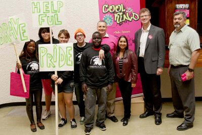 Supplied photo Campaign co-chairs Coun. Devi Sharma (third from right), Minister of Justice Andrew Swan (second from right), Winnipeg Police Association president Mike Sutherland (fourth from right, in back), vice-president George Van Mackelberg (far right), and students from the R.B. Russell Vocational School's Community Action Drama Group at the Cool 2Be Kind campaign launch on Sept. 18.
