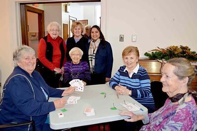 Coun. Devi Sharma (standing, far right) and President Edna Krosney (standing, centre) with participants of the bridge club at McBeth House.
