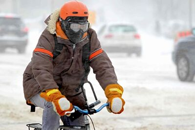 A cyclist wearing goggles navigates through Winnipeg's streets last winter. When driving this holiday season, make sure you keep an eye out for cyclists and give them plenty of space when passing.