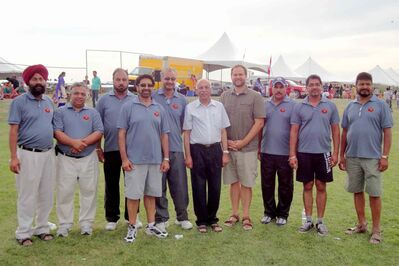Concordia MLA Matt Wiebe (fourth from right) and The Maples MLA Mohinder Saran (centre) join the organizers of the Sher-E-Punjab Sports Club tournament to congratulate them on their success.