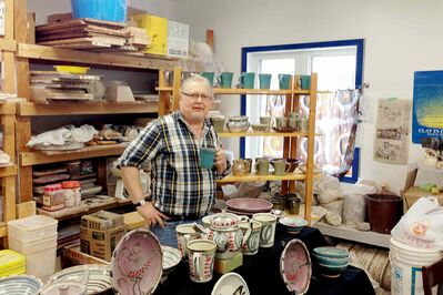 Artist Tom Roberts is pictured in his home pottery workshop. Roberts claims his stoneware will last 2,000 years.