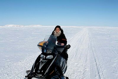 Krystalle Ramlakhan snowmobiling on Frobisher Bay.