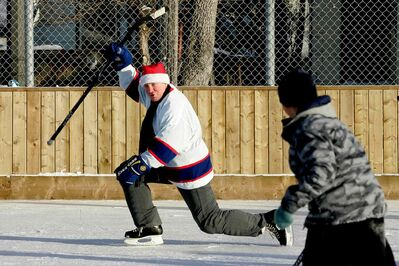 Thomas Steen, a former Winnipeg Jet and current city councillor, celebrates a goal after scoring at a 2010 charity hockey game. Steen, councillor responsible for youth and recreational opportunities in the city, is currently promoting the city's second annual campaign to collect donations of gently-used hockey gear.