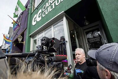 Stores in Ontario currently selling cannabis illegally will need to shut down before Oct. 17 and they apply for a legal retail licence. In this photo from March 2017, store manager Mark Harrison speaks to media outside a Cannabis Culture store following a police raid in Toronto on Thursday, March 9, 2017 (Aaron Vincent Elkaim / The Canadian Press files)