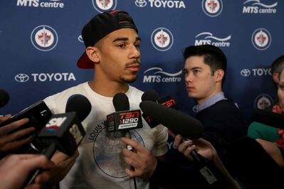 Winnipeg Jet Evander Kane (9) speaks to media as the team empties its lockers at the end of the season.